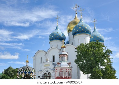 SERGIYEV, POSAD, MOSCOW REGION, RUSSIA - Church Domes Under Fleecy Clouds. View from Cathedral Square of Holy Trinity - St. Sergius Lavra on onion blue domes of Assumption Cathedral.