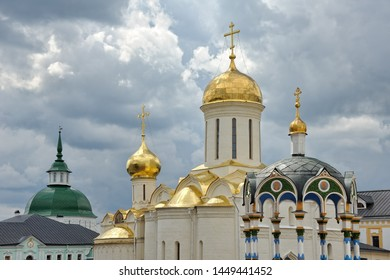 SERGIYEV POSAD, RUSSIA - Beautiful cupolas and towers of Holy Trinity-St. Sergius Lavra in Sergiyev Posad, the top-ranked monastery and spiritual center in Russia in the background of the grey clouds.