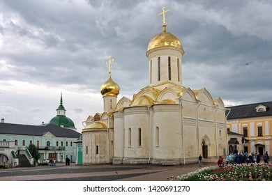 SERGIYEV POSAD, RUSSIA - Trinity Cathedral and Chapel of St. Nikon After a Spring Rain. View from Cathedral Square of Holy Trinity - St. Sergius Lavra on the old churches with golden onion cupolas.