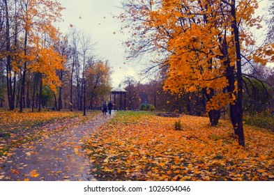 Sergiyev Posad,Russia-October 14,2017:Two men walking in the autumn park at rainy windy day.