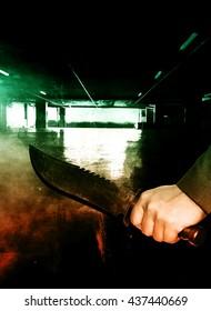 Serial killer with knife in moody scene background