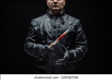 Serial killer maniac with knife and black gloves / killer tools