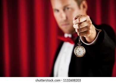 Series about a magician in a traditional tuxedo, with various props, looking mysterious and magical.