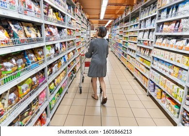 Series of Asian woman shopping groceries in modern supermarket with shopping cart selecting products