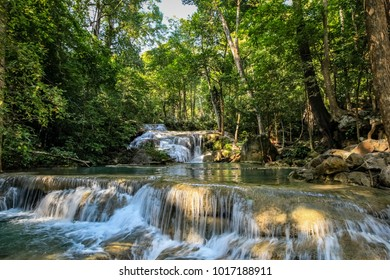 A series of beautiful short waterfalls in the dense forest