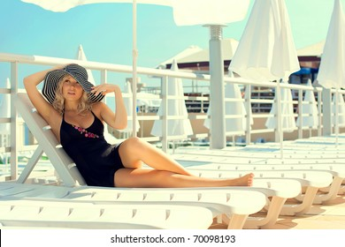Series the beautiful woman has a rest on the yacht