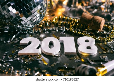 A series celebrating New Year's Eve, some with 2018 numerals.  Lots of confetti, champagne, etc. Good for background of ads.