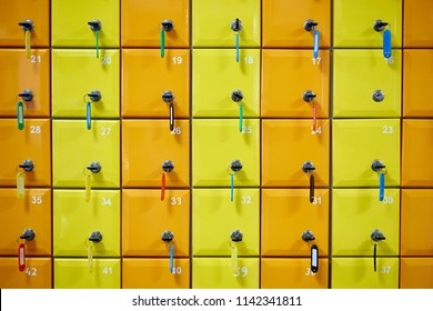 Series of colored, numbered lockers with locks, keys and tags.