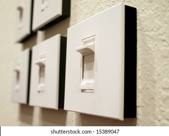 Series of Dimmer Switches on wall perspective