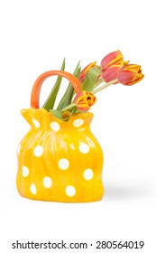 Series flower compositions isolated on white background. Red and yellow tulips in ceramic vase.