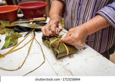 Series of a grandma preparing delicious tamales