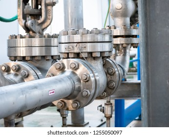 series of joints with flanges and bolts on an industrial pipe line, of the cooling water circuit of a plant
