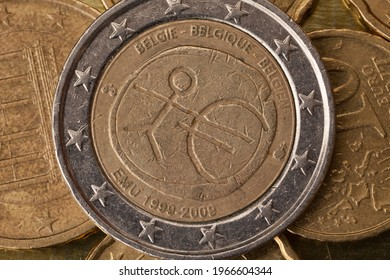 Series of macro shots of euro coins. Reverse of 2 Euro coin. Year of manufacture 2009. Country Belgium. Special coinage, 10 years Economic and Monetary Union (EMU)