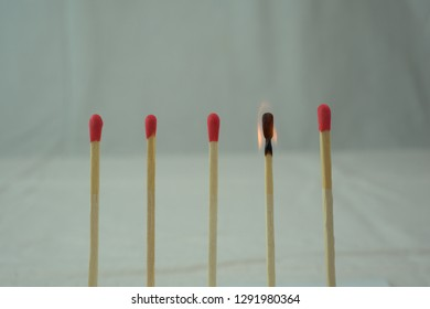a series of matches, some are burned