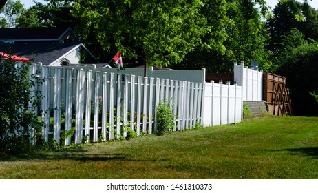 Series of mismatched residential fence sections facing a single yard