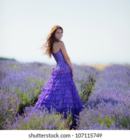 Series. Portrait of beautiful romantic woman in fairy field of lavender