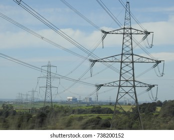 A series of pylons routing across the landscape to power all sorts of buildings etc.
