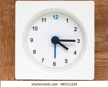 The series of the sequence of time on the simple white analog clock , 18/48