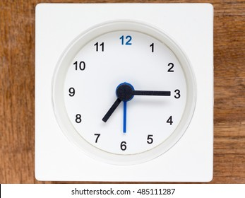 The series of the sequence of time on the simple white analog clock , 30/48