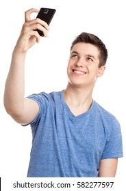 Series of shots of a nice teenage boy, just portraits, with digital tablet and making selfies with his smart phone