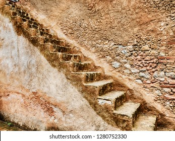A series of stone steps runs up outside a tower in the casbah of Chefchaouen in Morocco.