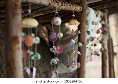 A series of wind chimes made from seashells