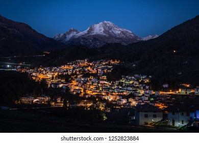 Serina mountain village illuminated at night