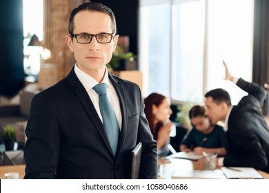Serious adult man in suit stands in front of office of family lawyer. Lawyer for family affairs and divorce. Family in office of family lawyer.