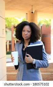 Serious African American Professional Business Person Pretty Beautiful Wearing Black Shirt and Suit