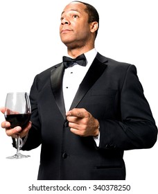 Serious African man with short black hair in evening outfit holding wine glass - Isolated