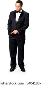 Serious African man with short black hair in evening outfit with hands in pockets - Isolated