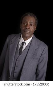 Serious african senior in grey suit, Studio Shot
