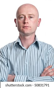 serious aged business man portrait in his middle  30's on white isolated. shaved bald head front on in shirt