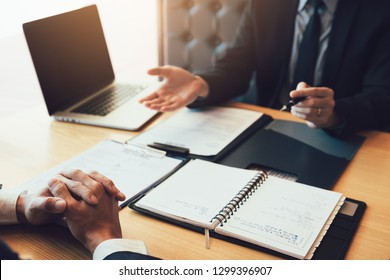 Serious asian businessman important conversation with male employee are reviewing resume documents.