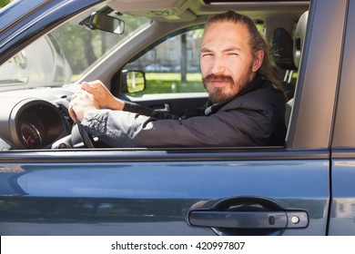 Serious Asian man as a driver of modern Japanese suv, portrait in open car window
