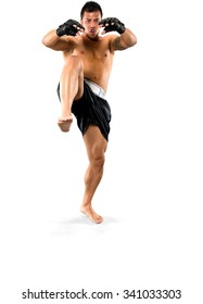 Serious Asian man with short black hair in athletic costume kicking - Isolated