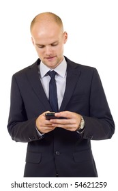 Serious attractive businessman texting with a mobile phone