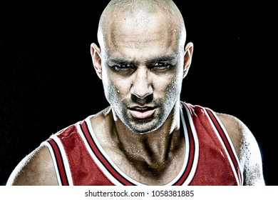 Serious basketball player looking straight to the camera