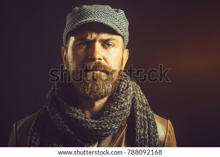 2967ef7d441 Serious bearded man with long beard dressed in brown leather jacket