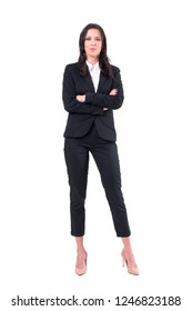 Serious bossy woman business manager with crossed arms looking at camera intense. Full body isolated on white background.