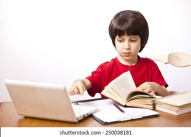 serious boy with a book and a netbook