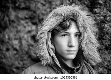 serious boy portrait with winter clothings - black and white photo