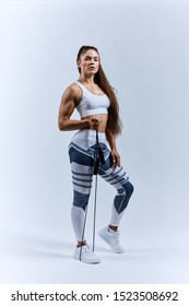 serious brunette woman with skipping rope posing to the camera. Resting time.lifestyle, free time, spare time