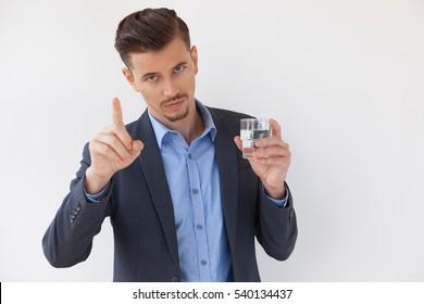 Serious Business Man Showing Warning Gesture