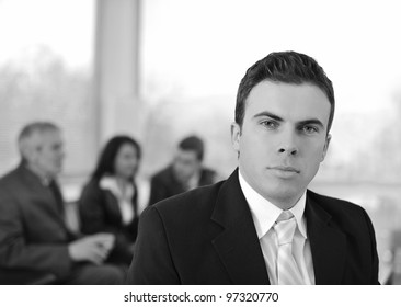 Serious businessman in company