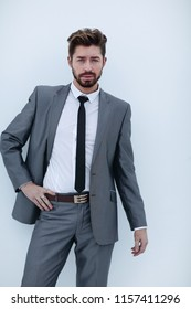 serious businessman with hands on hips, isolated background