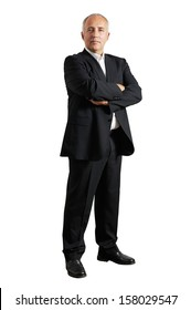 serious businessman standing in the studio and looking at camera
