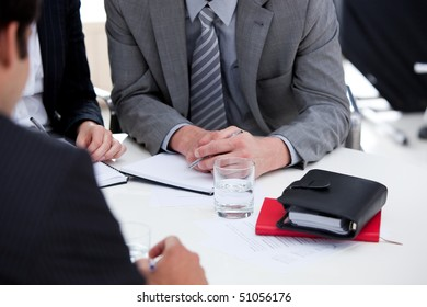 Serious businessmen having a brainstorming in a company
