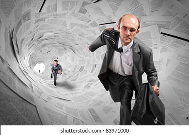 Serious businessmen running inside big documents tunnel