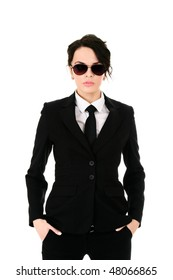 Serious businesswoman in black glasses holding hands in pockets isolated on white background